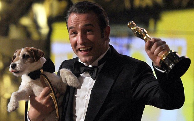 Jean DuJardin and Uggie the dog at the Oscars